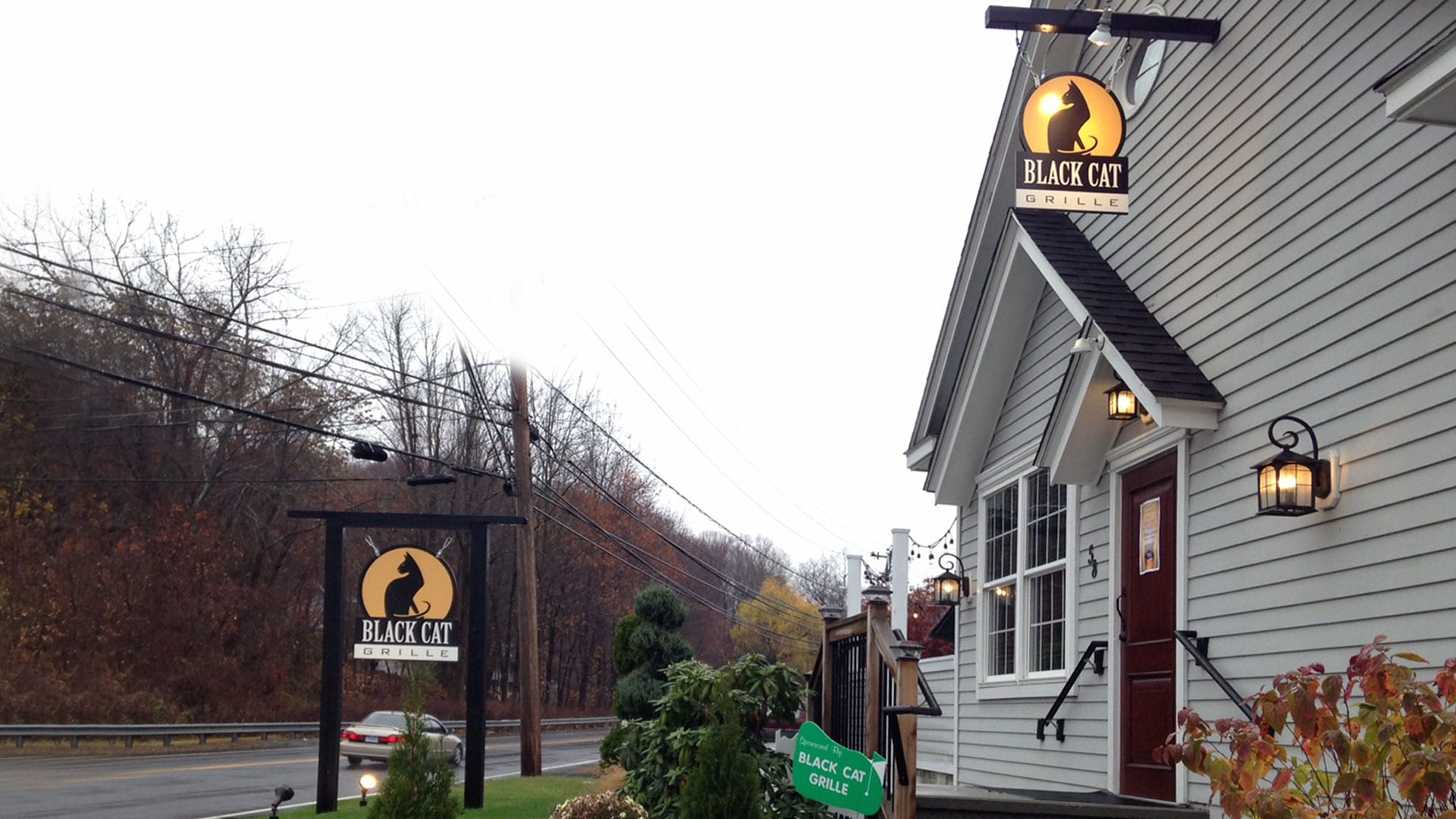 Two Hanging Signs for Black Cat Grille