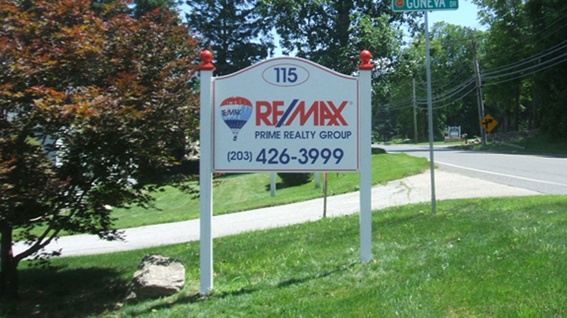 Real estate sign on uneven ground