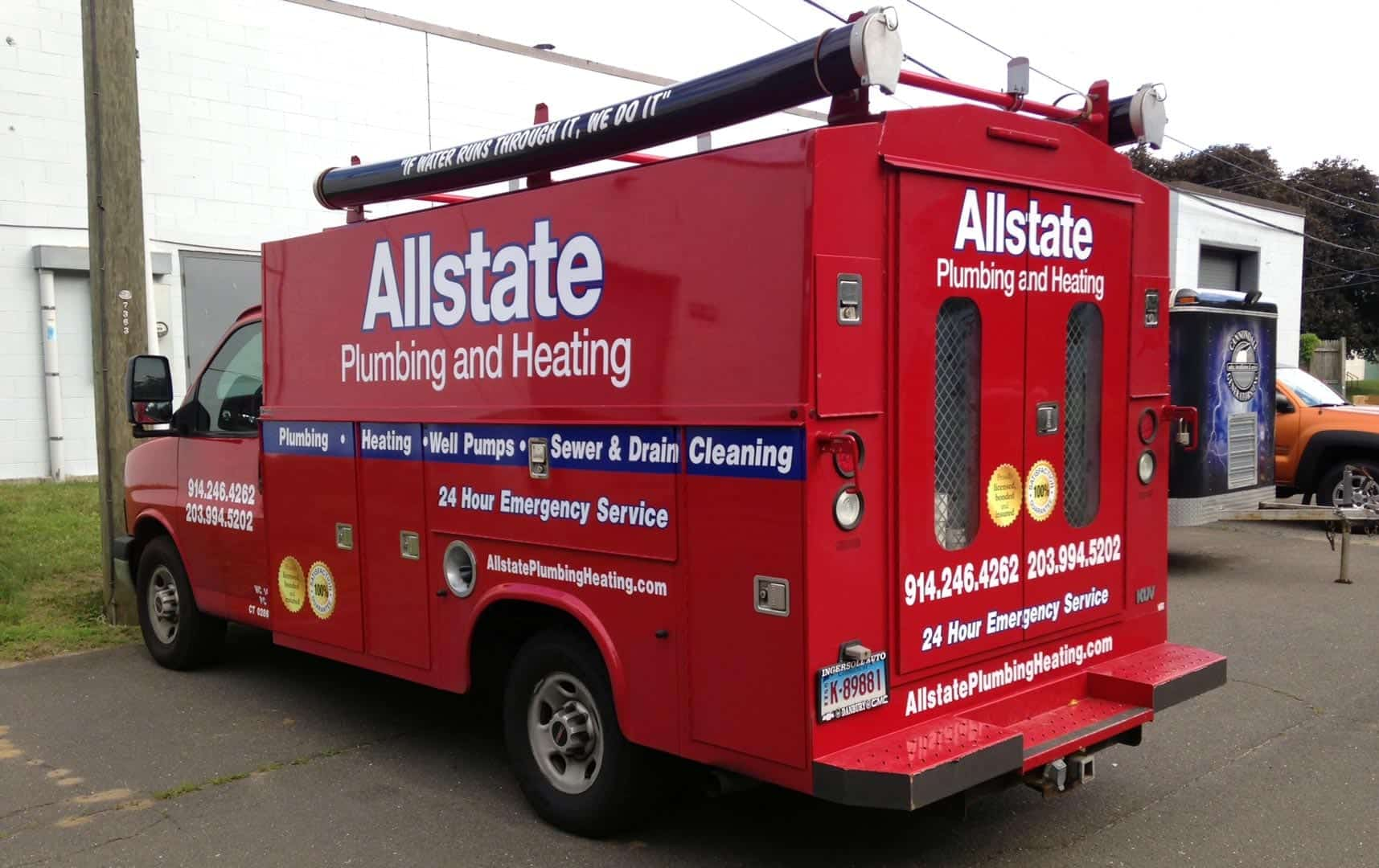 Full wrap and lettering on utility truck