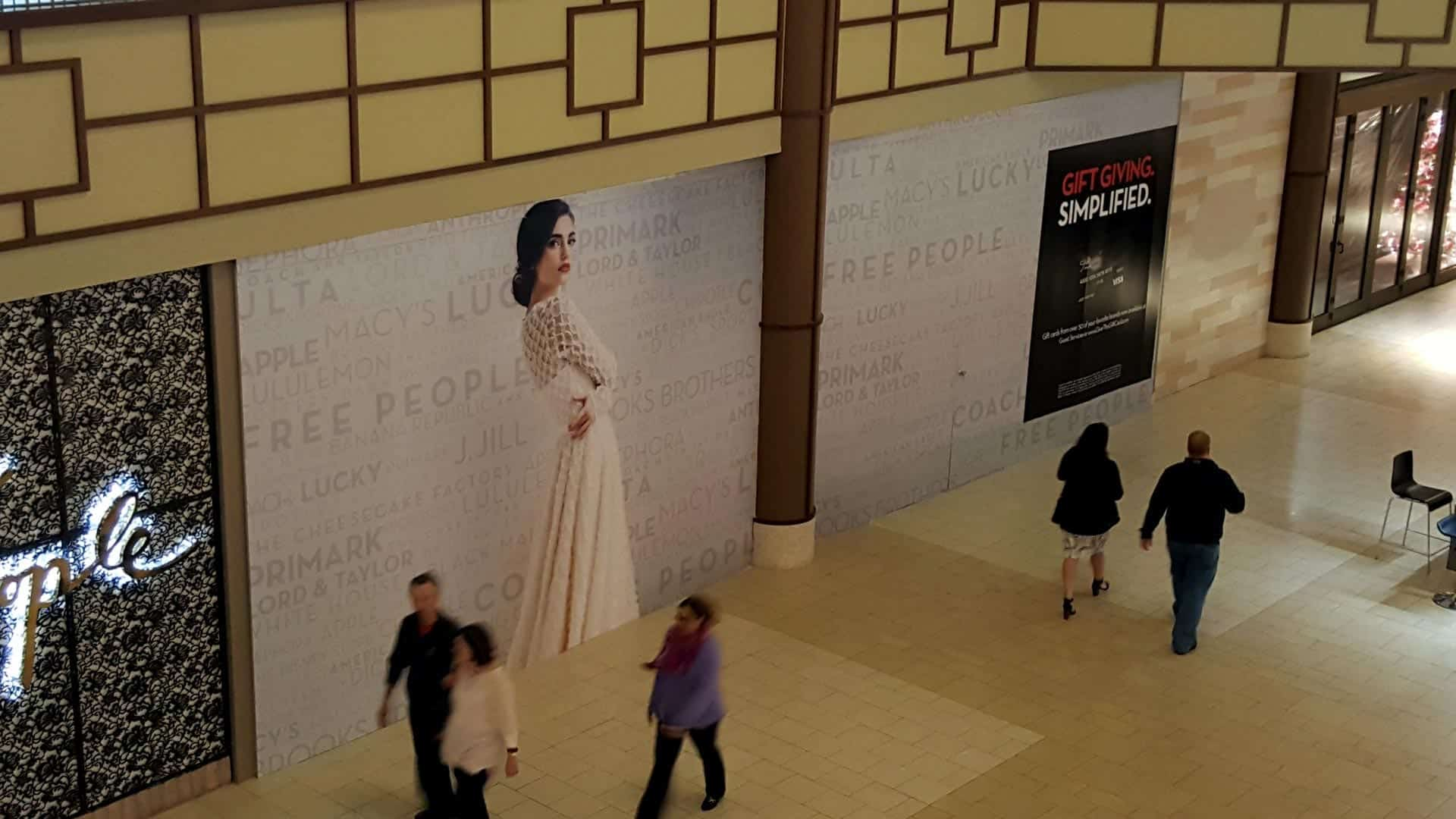 Wall wrap for an unopened store in mall