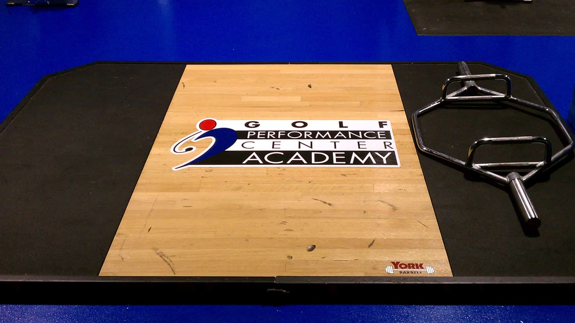 Logo decal on a wooden gym floor