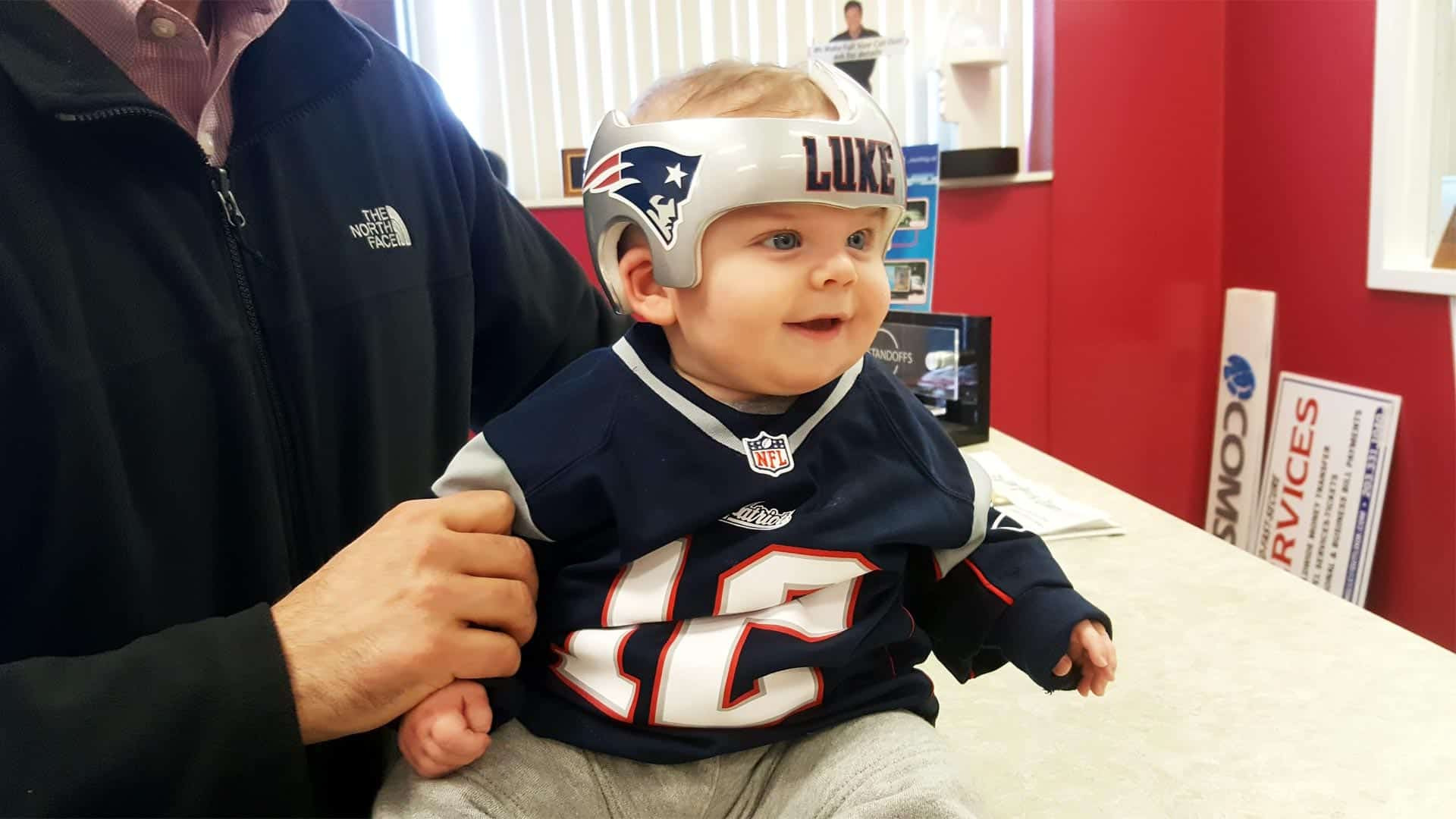 Baby wearing a New England Patriots doc band