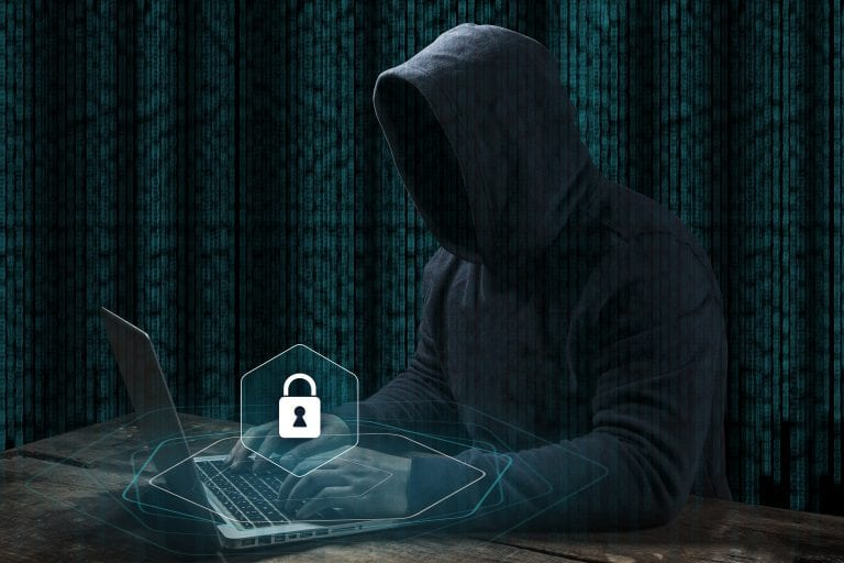 Anonymous computer hacker over abstract digital background.
